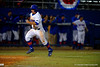 Florida Gators catcher Mike Rivera sprints around third and across home during the third inning.  Florida Gators vs Rhode Island Rays.  February 13th, 2015. Gator Country photo by David Bowie.