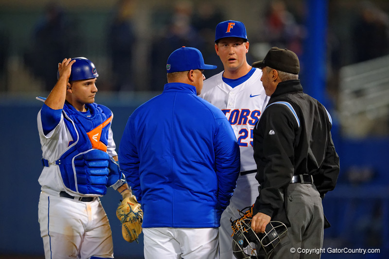 Florida Gators pitcher Eric Hanhold on the mound in relief but is taking out while warming up and heads into the dugout.  Florida Gators vs Rhode Island Rays.  February 13th, 2015. Gator Country photo by David Bowie.