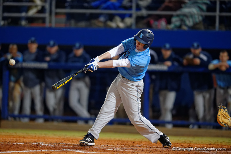 A Rhode Island batter drives a ball in the fifth inning for a hit.  Florida Gators vs Rhode Island Rays.  February 13th, 2015. Gator Country photo by David Bowie.