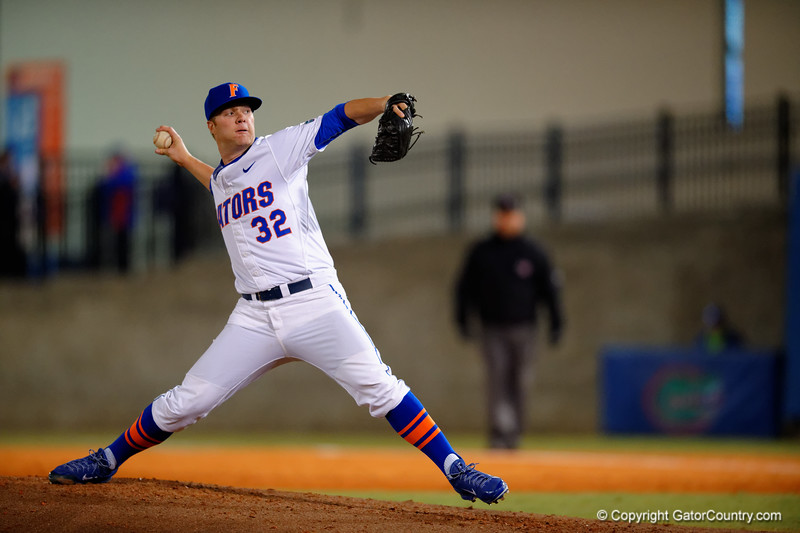 Florida Gators pitcher Logan Shore pitching during the fourth inning.  Florida Gators vs Rhode Island Rays.  February 13th, 2015. Gator Country photo by David Bowie.