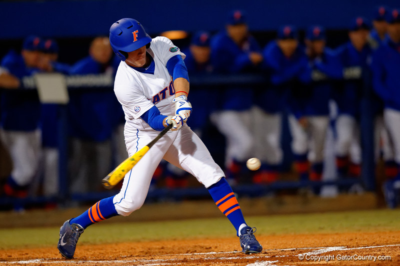 Florida Gators outfielder Harrison Bader swings at a pitch during the first inning.  Florida Gators vs Rhode Island Rays.  February 13th, 2015. Gator Country photo by David Bowie.