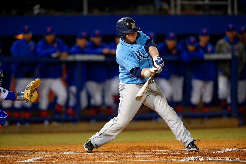 A Rhode Island batter drives the ball for a single in the second inning.  Florida Gators vs Rhode Island Rays.  February 13th, 2015. Gator Country photo by David Bowie.