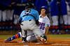Florida Gators outfielder Ryan Larson slides into home and Rhode Island catcher Chase Livingston to score in the third inning.  Florida Gators vs Rhode Island Rays.  February 13th, 2015. Gator Country photo by David Bowie.