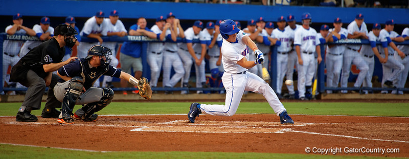 Florida Gators outfielder Harrison Bader swings at a pitch as the Gators watch on from the dugout during Thursday nights loss to the Auburn Tigers 4-1.  May 14th, 2015. Gator Country photo by David Bowie.