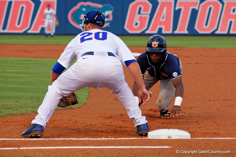 Auburn Tigers infielder Melvin Gray slides back towards first base during Thursday nights win over the Florida Gators 4-1. May 14th, 2015. Gator Country photo by David Bowie.