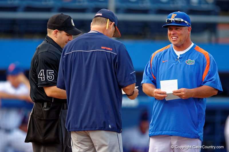 Florida Gators head coach Kevin O'Sullivan meets at home plate during Thursday nights loss to the Auburn Tigers 4-1.  May 14th, 2015. Gator Country photo by David Bowie.