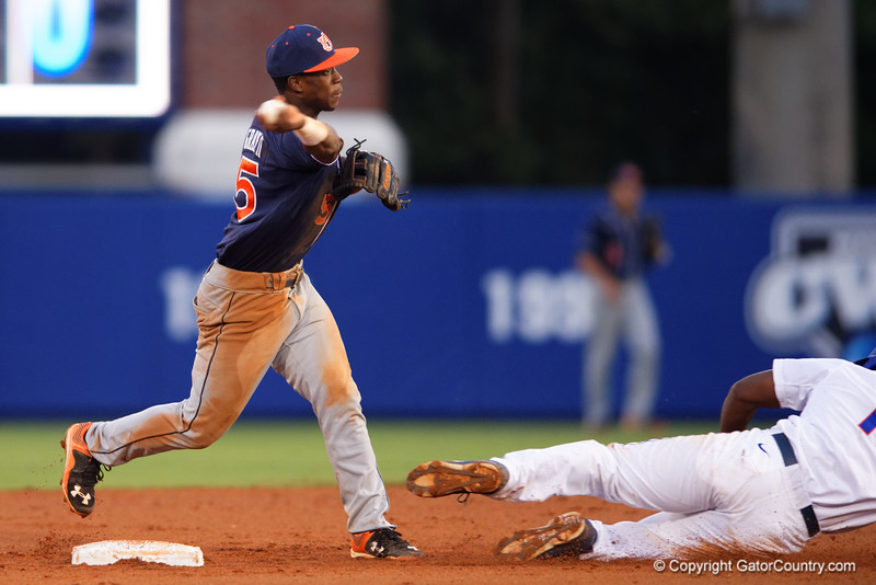 Auburn Tigers infielder Melvin Gray touches second and throws to first base for a double play in the fourth innng during Thursday nights win over the Florida Gators 4-1..  May 14th, 2015. Gator Country photo by David Bowie.