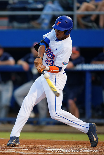 Florida Gators outfielder Buddy Reed swings and connects in the fourth inning during Thursday nights loss to the Auburn Tigers 4-1.  May 14th, 2015. Gator Country photo by David Bowie.