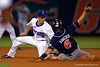 Florida Gators catcher Mike Rivera throws to second base and Florida Gators infielder Dalton Guthrie tags out Auburn Tigers thrid baseman Damon Haecker during Thursday nights Gators loss to the Auburn Tigers 4-1.  May 14th, 2015. Gator Country photo by David Bowie.