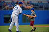 A young Gators fan throws out the first pitch and is congratulated by Florida Gators pitcher Aaron Rhodes during Thursday nights loss to the Auburn Tigers 4-1.  May 14th, 2015. Gator Country photo by David Bowie.