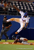 Florida Gators infielder Josh Tobias flies through the air not able to hold onto the ball as Auburn Tigers outfielder Anfernee Grier slides into third during Thursday nights Gators loss to the Auburn Tigers 4-1.  May 14th, 2015. Gator Country photo by David Bowie.