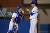 Florida Gators catcher Mike Rivera comes out to talk with Florida Gators pitcher Eric Hanhold during Thursday nights Gators loss to the Auburn Tigers 4-1.  May 14th, 2015. Gator Country photo by David Bowie.