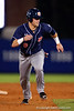 Auburn Tigers outfielder Austin Murphy sprints toward third base during Thursday nights Gators loss to the Auburn Tigers 4-1.  May 14th, 2015. Gator Country photo by David Bowie.