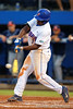 Florida Gators infielder Josh Tobias swings and singles in the fourth inning during Thursday nights loss to the Auburn Tigers 4-1.  May 14th, 2015. Gator Country photo by David Bowie.