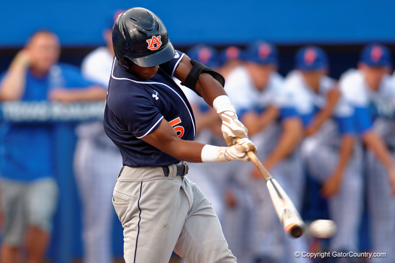 Auburn Tigers infielder Melvin Gray drives the ball for a singke during Thursday nights win over the Florida Gators 4-1.  May 14th, 2015. Gator Country photo by David Bowie.