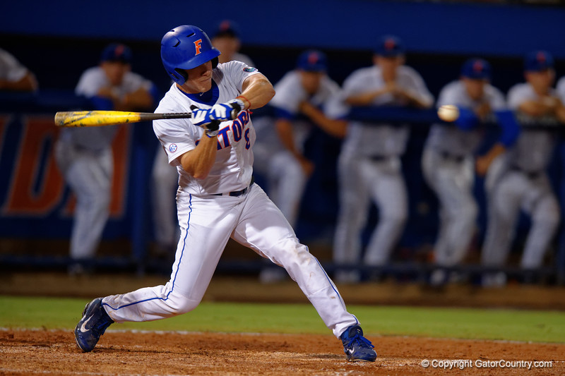 Florida Gators outfielder Harrison Bader swings at a pitch in the eighth inning during Thursday nights Gators loss to the Auburn Tigers 4-1.  May 14th, 2015. Gator Country photo by David Bowie.