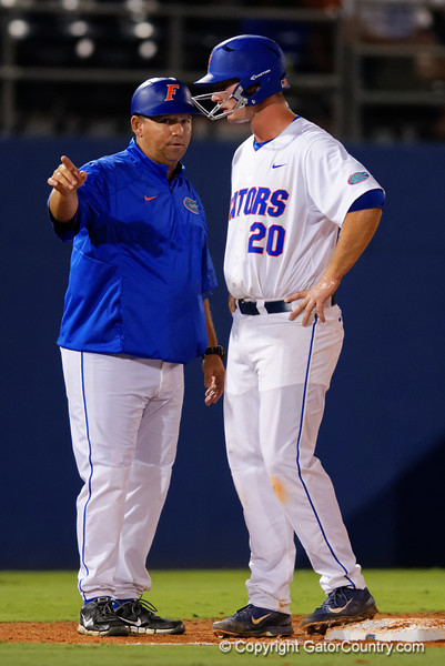 Florida Gators assistant coach Craig Bell coaching up Florida Gators infielder Peter Alonso on third base during Thursday nights Gators loss to the Auburn Tigers 4-1.  May 14th, 2015. Gator Country photo by David Bowie.