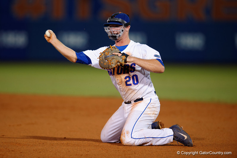 Florida Gators infielder Peter Alonso throws to first for an out from his knees after diving for the ball during Thursday nights Gators loss to the Auburn Tigers 4-1.  May 14th, 2015. Gator Country photo by David Bowie.