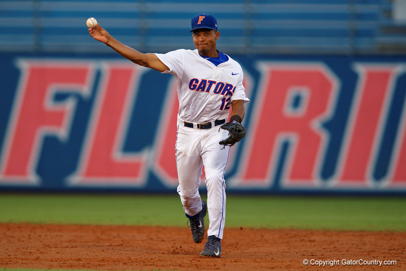 Florida Gators shortstop Richie Martin throws to first base for an out in the second inning during Thursday nights loss to the Auburn Tigers 4-1.  May 14th, 2015. Gator Country photo by David Bowie.