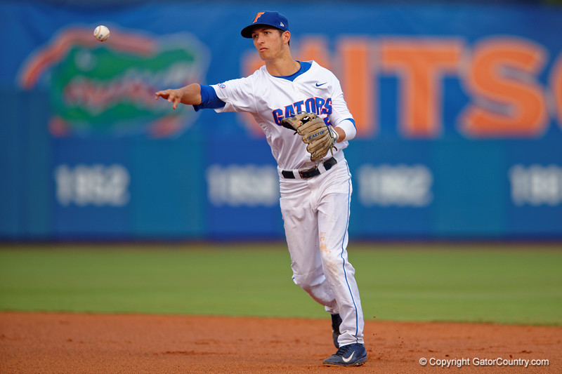 Florida Gators infielder Dalton Guthrie fields a ball and throws to first for an out during Thursday nights loss to the Auburn Tigers 4-1.  May 14th, 2015. Gator Country photo by David Bowie.