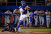 Florida Gators catcher Mike Rivera leaps into the air for the ball as an Auburn Tiger baserunner slides into home during Thursday nights Gators loss to the Auburn Tigers 4-1.  May 14th, 2015. Gator Country photo by David Bowie.