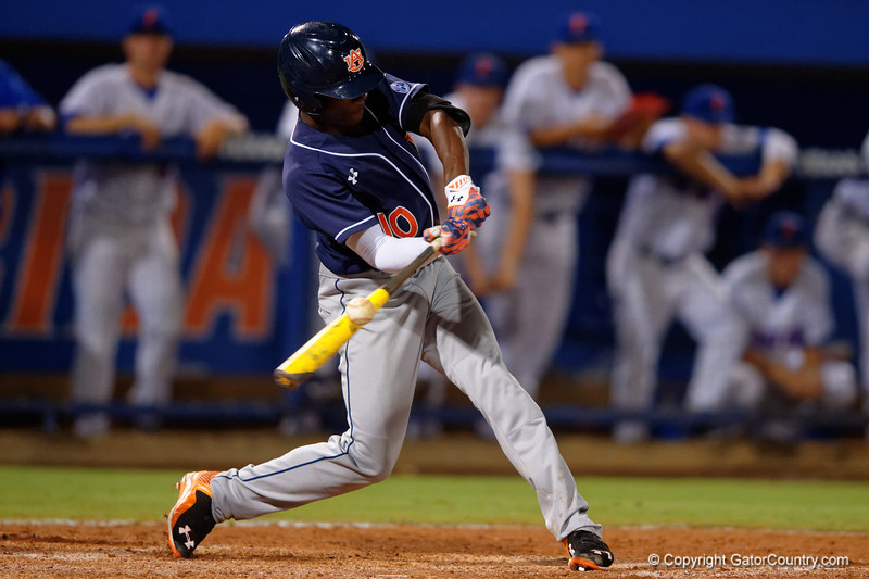 Auburn Tigers outfielder Anfernee Grier drives a ball during Thursday nights Gators loss to the Auburn Tigers 4-1.  May 14th, 2015. Gator Country photo by David Bowie.