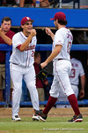 FSU pitcher Dylan Silva congratulates pitcher Mike Compton after retiring the Gators in the first during Game 2 of the Super Regionals as the Florida Gators defeat the Florida State Seminoles 11-4.  June 6th, 2015. Gator Country photo by David Bowie.