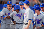 Florida Gators shortstop Richie Martin homers in the third inning over the left field wall during Game 2 of the Super Regionals as the Florida Gators defeat the Florida State Seminoles 11-4.  June 6th, 2015. Gator Country photo by David Bowie.