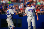 Florida Gators catcher JJ Schwarz hands pitcher A.J Puk the ball as he comes out to talk to him in the fourth during Game 2 of the Super Regionals as the Florida Gators defeat the Florida State Seminoles 11-4.  June 6th, 2015. Gator Country photo by David Bowie.