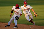 FSU infielders John Sansone (12) and Taylor Walls (10)  look down at the ball as the Gator runners advance on a pass ball during Game 2 of the Super Regionals as the Florida Gators defeat the Florida State Seminoles 11-4.  June 6th, 2015. Gator Country photo by David Bowie.