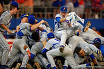 Florida Gators pitcher Kirby Snead and the Gators celebrate in a dog pile as they defeat the Florida State Seminoles 11-4 to advance to the College World Series for the first time since 2012.  June 6th, 2015. Gator Country photo by David Bowie.