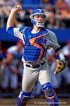 Florida Gators catcher JJ Schwarz throws to first for an out in the third inning during Game 2 of the Super Regionals as the Florida Gators defeat the Florida State Seminoles 11-4.  June 6th, 2015. Gator Country photo by David Bowie.
