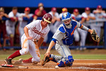 FSU outfielder Josh Delph slides into home past Florida Gators catcher JJ Schwarz who cant hang onto the ball during Game 2 of the Super Regionals as the Florida Gators defeat the Florida State Seminoles 11-4.  June 6th, 2015. Gator Country photo by David Bowie.