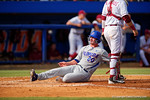 Florida Gators infielder Peter Alonso slides into home in the ssecond inning giving the Gators a 3-2 lead during Game 2 of the Super Regionals as the Florida Gators defeat the Florida State Seminoles 11-4.  June 6th, 2015. Gator Country photo by David Bowie.