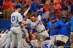 Florida Gators shortstop Richie Martin and the Gators celebrate in a dog pile as they defeat the Florida State Seminoles 11-4 to advance to the College World Series for the first time since 2012.  June 6th, 2015. Gator Country photo by David Bowie.