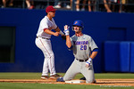 Florida Gators infielder Peter Alonso motions You Can't See Me as he triples in the third inning giving the Gators a 7-2 lead during Game 2 of the Super Regionals as the Florida Gators defeat the Florida State Seminoles 11-4.  June 6th, 2015. Gator Country photo by David Bowie.