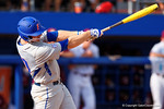 Florida Gators infielder Peter Alonso triples in the third inning scoring Florida Gators catcher JJ Schwarz bringing the score to 7-2 during Game 2 of the Super Regionals as the Florida Gators defeat the Florida State Seminoles 11-4.  June 6th, 2015. Gator Country photo by David Bowie.