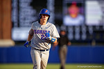 Florida Gators catcher JJ Schwarz homers in the sixth inning during Game 2 of the Super Regionals as the Florida Gators defeat the Florida State Seminoles 11-4.  June 6th, 2015. Gator Country photo by David Bowie.