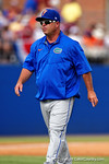 Florida Gators head coach Kevin O'Sullivan walking back to the dugout after coming out to calm down Florida Gators first pitcher A.J Puk during Game 2 of the Super Regionals as the Florida Gators defeat the Florida State Seminoles 11-4.  June 6th, 2015. Gator Country photo by David Bowie.