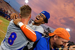 Florida Gators outfielder Buddy Reed gives Florida Gators outfielder Harrison Bader a hug as the Gators celebrate as they defeat the Florida State Seminoles 11-4 to advance to the College World Series for the first time since 2012.  June 6th, 2015. Gator Country photo by David Bowie.