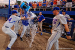 Florida Gators pitcher Logan Shore and Florida Gators outfielder Harrison Bader give Florida Gators head coach Kevin O'Sullivan a water bath as the Gators celebrate as they defeat the Florida State Seminoles 11-4 to advance to the College World Series for the first time since 2012.  June 6th, 2015. Gator Country photo by David Bowie.