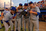 Florida Gators outfielder Buddy Reed, Florida Gators shortstop Richie Martin, Florida Gators infielder John Sternagel and Florida Gators pitcher Kirby Snead pose for the camera as the Gators celebrate as they defeat the Florida State Seminoles 11-4 to advance to the College World Series for the first time since 2012.  June 6th, 2015. Gator Country photo by David Bowie.