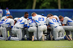The Gators gather in prayor before they take the field during Game 2 of the Super Regionals as the Florida Gators defeat the Florida State Seminoles 11-4.  June 6th, 2015. Gator Country photo by David Bowie.