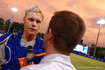 Florida Gators catcher JJ Schwarz does a post game interview wearing a pie that was thrown in his face during Game 2 of the Super Regionals as the Florida Gators defeat the Florida State Seminoles 11-4.  June 6th, 2015. Gator Country photo by David Bowie.