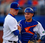 Florida Gators catcher Mike Rivera congratulates Florida Gators pitcher Logan Shore after the first inning.  Florida Gators Baseball vs South Carolina Gamecocks.  April 10th, 2015. Gator Country photo by David Bowie.