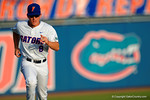 Florida Gators outfielder Harrison Bader runs toward the Gators dugout.  Florida Gators Baseball vs South Carolina Gamecocks.  April 10th, 2015. Gator Country photo by David Bowie.