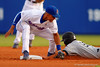 Florida Gators shortstop Richie Martin tags out a South Carolina infielder Max Schrock.  Florida Gators Baseball vs South Carolina Gamecocks.  April 10th, 2015. Gator Country photo by David Bowie.