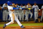 Florida Gators shortstop Richie Martin swings and singles in the fifth inning.  Florida Gators Baseball vs South Carolina Gamecocks.  April 10th, 2015. Gator Country photo by David Bowie.