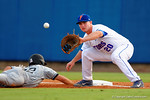 Florida Gators infielder Peter Alonso looks in the ball for a tag at first.  Florida Gators Baseball vs South Carolina Gamecocks.  April 10th, 2015. Gator Country photo by David Bowie.
