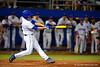Florida Gators catcher JJ Schwarz singles.  Florida Gators Baseball vs South Carolina Gamecocks.  April 10th, 2015. Gator Country photo by David Bowie.